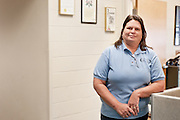 October Employee of the month, Lori Walter, in front of her office in Ping.