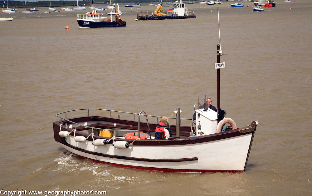 The small ferry boat crosses the River Deben between Bawdsey Quay and Felixstowe Ferry, Suffolk, England