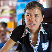 CAPTION: Hue moved back to Huy Tuong in 2012 to marry the man who is now her husband, after working as a wage labourer in Hanoi. She joined Nha Luong's Women's Association the following year, through which she received training on innovative livestock breeding and cultivation techniques as part of We Effect's project in Huy Tuong. LOCATION: Huy Tuong, Son La Province, Vietnam. INDIVIDUAL(S) PHOTOGRAPHED: Lo Thi Hue.