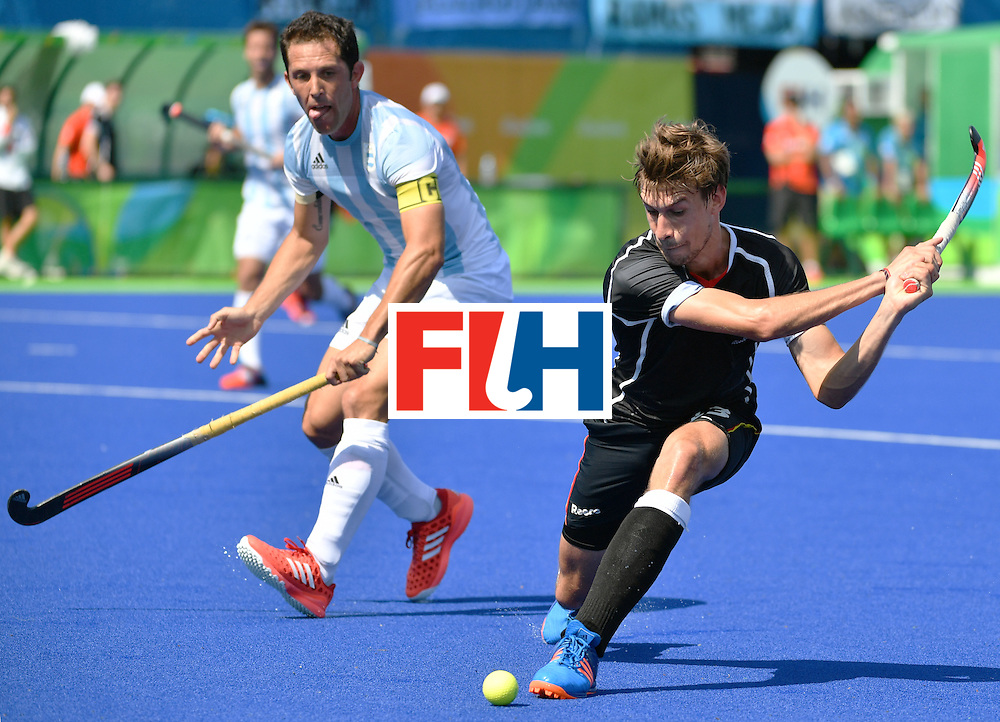 Germany's Florian Fuchs (R) vies with Argentina's Pedro Ibarra during the men's semifinal field hockey Argentina vs Germany match of the Rio 2016 Olympics Games at the Olympic Hockey Centre in Rio de Janeiro on August 16, 2016. / AFP / Pascal GUYOT        (Photo credit should read PASCAL GUYOT/AFP/Getty Images)