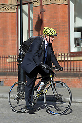 Boris Johnson arrives on his bike at St Pancras Station.<br /> Mayor of London Boris Johnson joins musicians at St Pancras Station to urge young musicians to take to the streets and continue busking in the Capital.  <br /> <br /> Wednesday, 9th April 2014. Picture by Ben Stevens / i-Images