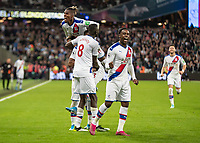 Football - 2019 / 2020 Premier League - West Ham United vs. Crystal Palace <br /> <br /> Crystal Palace players celebrate in front of the home supporters after VAR overruled the Assistant Referees offside decision at the London Stadium<br /> <br /> COLORSPORT/DANIEL BEARHAM