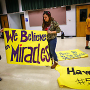 Tayler Hoftell, 17, and Emmarae Reuwsaat, 17, make signs at Darrington High School. In the wake of Saturday's mudslide on Highway 530 in Snohomish County, there have been 175 reports of missing people and the death toll has risen to 14.