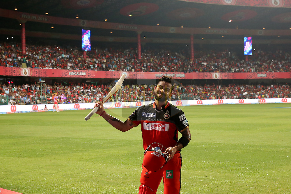 Royal Challengers Bangalore skipper Virat Kohli acknowledges the crowd as he returns the pavilion during match 50 of the Vivo IPL ( Indian Premier League ) 2016 between the Royal Challengers Bangalore and the Kings XI Punjab held at The M. Chinnaswamy Stadium in Bangalore, India,  on the 18th May 2016<br /> <br /> Photo by Faheem Hussain / IPL/ SPORTZPICS