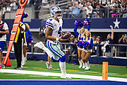 ARLINGTON, TX - OCTOBER 14:  Dak Prescott #4 of the Dallas Cowboys runs the ball for a touchdown in the first half of a game against the Jacksonville Jaguars at AT&T Stadium on October 14, 2018 in Arlington, Texas.  The Cowboys defeated the Jaguars 40-7.  (Photo by Wesley Hitt/Getty Images) *** Local Caption *** Dak Prescott