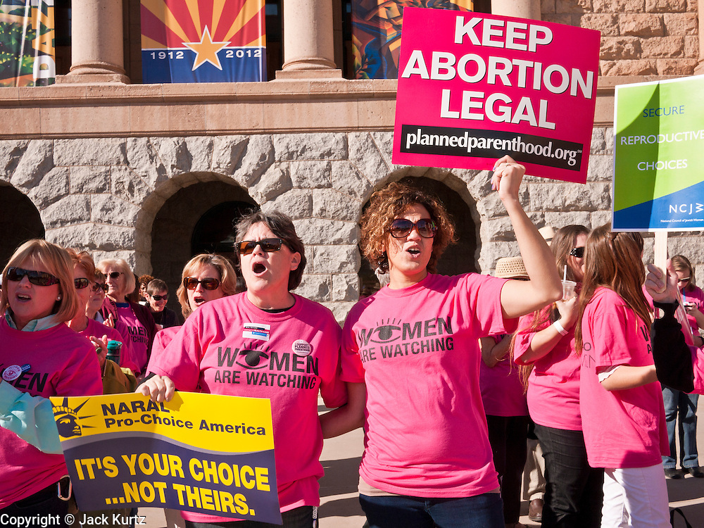 09 JANUARY 2012 - PHOENIX, AZ:  Cristy Cohn (CQ LEFT) and her daughter Liz Mings (CQ) demonstate in support of pro-choice at the state legislature Monday. Gov Brewer delivered her State of the State inside while outside representatives of interest groups picketed and protested.  There were more than 300 pro-choice demonstrators at the capitol and only about 50 pro-life demonstrators.  The Arizona legislature started its 2012 session and Gov. Jan Brewer delivered her State of the State Monday, Jan 9.                   PHOTO BY JACK KURTZ