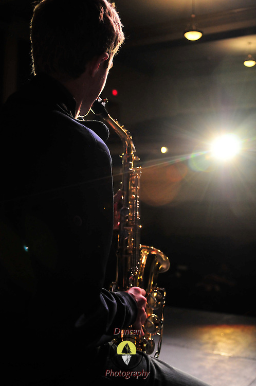 11/12/10 -- BATH, Maine.   Max Rawson, 17, of Bath, rehearses his saxophone solo for MOHIBA on Friday afternoon at Morse's Montgomery Theater. MOHIBA, Morse's annual variety show, stands for Morse High Bazaar. The show will be performed at 7:00 pm on Friday and Saturday nights. Roger S. Duncan Photo For the Forecaster.