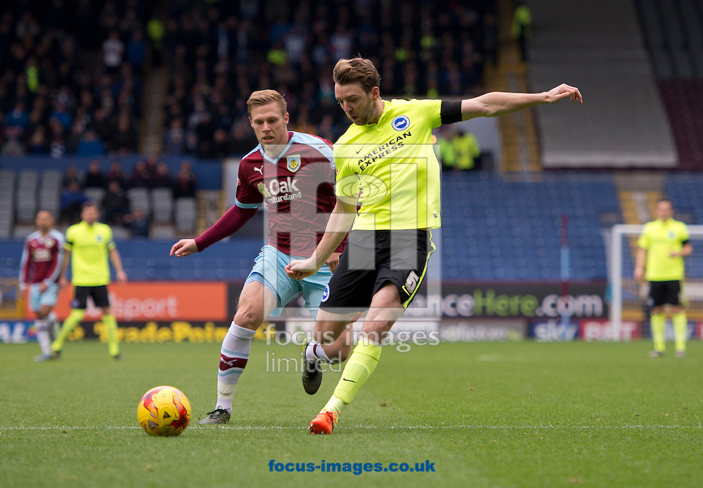 Dale Stephens of Brighton and Hove Albion (2nd right) looks to find a way past as he is closed down by Scott Arfield of Burnley (3rd left) during the Sky Bet Championship match at Turf Moor, Burnley<br /> Picture by Russell Hart/Focus Images Ltd 07791 688 420<br /> 22/11/2015