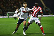 Preston North End midfielder Brad Potts (44) and Stoke City midfielder Oghenekaro Etebo (8) challenge for the ball during the EFL Sky Bet Championship match between Preston North End and Stoke City at Deepdale, Preston, England on 21 August 2019.