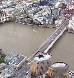© Licensed to London News Pictures. 14/10/2015. London, UK. London Bridge in central London is currently closed by police due to a suspect package. traffic in both directions over the bridge has been stopped. . Photo credit: Calum Williams/LNP