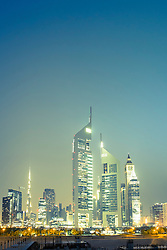 Night skyline view of financial district in Dubai United Arab Emirates