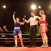Linda Coultrip (red) and Teresa Wallace (blue) after their bout  in the 'Thriller in the Chiller' charity boxing event as part of the Queenstown Winter Festival at the Queenstown Events Centre , South Island, New Zealand, 25th June 2011