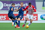 Mason Bloomfield (#16) of Hamilton Academical FC beats Christophe Berra (#6) of Heart of Midlothian and Olly Lee of Heart of Midlothian to the ball during the Ladbrokes Scottish Premiership League match between Hamilton Academical FC and Heart of Midlothian FC at New Douglas Park, Hamilton, Scotland on 4 August 2018. Picture by Malcolm Mackenzie.