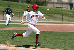 18 April 2010: Brett Kay bunts the ball into play and then tries to outrun it to first. The ball won.  Southern Illinois Salukis and the Illinois State Redbirds face off on Duffy Bass Field on the campus of Illinois State University in Normal Illinois.