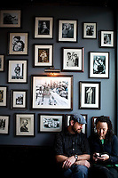 NAMES CQ: Micah and Dene Dirkson, of Napa, wait for their table under a wall of family pictures at the Norman Rose Tavern, on Saturday, May 22, 2010.