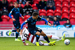 Tom Nichols of Bristol Rovers is tackled by Ben Whiteman of Doncaster Rovers - Mandatory by-line: Robbie Stephenson/JMP - 19/10/2019 - FOOTBALL - The Keepmoat Stadium - Doncaster, England - Doncaster Rovers v Bristol Rovers - Sky Bet League One