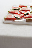 Watermelon slices on chopping board close-up