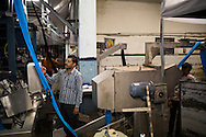 Workers test textiles in the Pratibha vertically integrated garment unit in Indore, Madhya Pradesh, India on 11 November 2014. Photo by Suzanne Lee for Fairtrade
