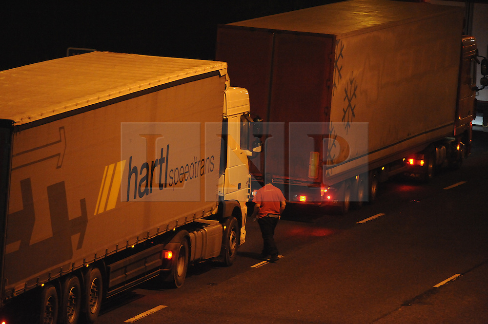 © Licensed to London News Pictures. 22/01/2015<br /> Lorry drivers sleeping.<br /> Hundreds of lorries stuck on the M20 between Junction 7 Bearsted and Junction 8 for Leeds in Kent<br /> Lorry drivers and other motorists are suffering a very cold night (23.01.2015) stuck in Operation Stack on the M20 in Kent after a fire in the Channel Tunnel last weekend.<br />   Operation Stack is to continue into the weekend, according to Kent Police.The massive backlog of freight on the M20 could take until Saturday to clear meaning another day of disruption for Kent's roads.commuters urged to find alternative routes.<br /> (Byline:Grant Falvey/LNP)