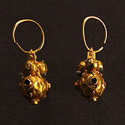 Gold earrings.  Spheres with inlaid garnets, Hungary