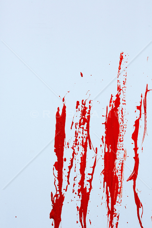 splatter of red paint on a white wall
