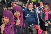 Girls in hijabs (headscarfes) from Eden Girl's school, in Waltham Forest, show their support in front of Scots fans in town for the football international - Silence in the Square oraganised by the British Legion in Trafalgar Square  - 11 November 2016, London.