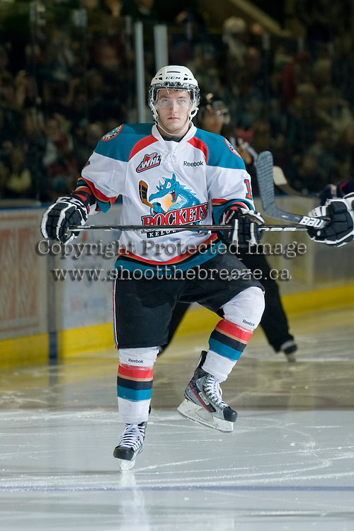 KELOWNA, CANADA, JANUARY 25: Cody Chikie #14 of the Kelowna Rockets stretches on the ice as the Kamloops Blazers visit the Kelowna Rockets on January 25, 2012 at Prospera Place in Kelowna, British Columbia, Canada (Photo by Marissa Baecker/Getty Images) *** Local Caption ***