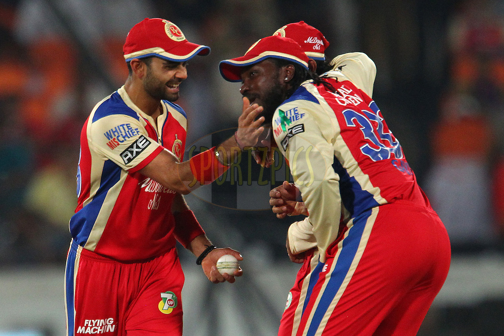 Virat Kohli, Tilakaratne Dilshan and Chris Gayle laugh after Gayle was hit by the ball during match 7 of the Pepsi Indian Premier League between The Sunrisers Hyderabad and Royal Challengers Bangalore held at the Rajiv Gandhi International  Stadium, Hyderabad  on the 7th April 2013..Photo by Ron Gaunt-IPL-SPORTZPICS   ..Use of this image is subject to the terms and conditions as outlined by the BCCI. These terms can be found by following this link:..http://www.sportzpics.co.za/image/I0000SoRagM2cIEc