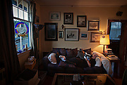 Owner Ann Nelson relaxes with her cat Princess Diva in the living room of the apartment above 100-year-old Patricia Theatre in Powell River, BC (2013)