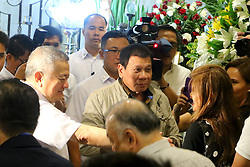 """October 2, 2016 - Philippines - Jun Santiago (husband of Sen. Santiago,left) assisted President Rodrigo Duterte (center) while talking Ilocos Norte Governor Maria Imelda Josefa  """"Imee"""" Romualdez Marcos (right) during the wake of Sen. Miriam Defensor Santiago at Immaculate Conception Cathedral in Quezon City. Sen. Santiago pass-away last September 29, 2016 due to her stage 4 lung cancer and she is one of the candidates for presidential election 2016. (Credit Image: © Gregorio B.Dantes Jr/Pacific Press via ZUMA Wire)"""