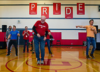 Bob Clay shows off his dance moves to Justin Spencer and Ryan Vezina of Recycled Percussion during their surprise visit to Laconia Middle School on Monday afternoon.  (Karen Bobotas/for the Laconia Daily Sun)