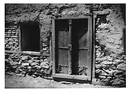 Heavy wooden door set into stone wall in Murad Khane, Kabul, Afghanistan.