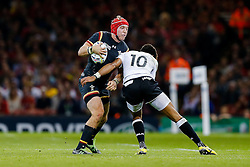 Wales Outside Centre Tyler Morgan is tackled by Fiji Fly-Half Ben Volavola - Mandatory byline: Rogan Thomson/JMP - 07966 386802 - 01/10/2015 - RUGBY UNION - Millennium Stadium - Cardiff, Wales - Wales v Fiji - Rugby World Cup 2015 Pool A.