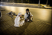 "Homeless heroin addicts in the middle of the street, right in front of Bala Hisar Fort, one of the most historic places of town. One of them is just a young boy. Peshawar, Pakistan, on monday, August 25 2008.....""Pakistan is one of the countries hardest hits by the narcotics abuse into the world, during the last years it is facing a dramatic crisis as it regards the heroin consumption. The Unodc (United Nations Office on Drugs and Crime) has reported a conspicuous decline in heroin production in Southeast Asia, while damage to a big expansion in Southwest Asia. Pakistan falls under the Golden Crescent, which is one of the two major illicit opium producing centres in Asia, situated in the mountain area at the borderline between Iran, Afghanistan and Pakistan itself. .During the last 20 years drug trafficking is flourishing in the Country. It is the key transit point for Afghan drugs, including heroin, opium, morphine, and hashish, bound for Western countries, the Arab states of the Persian Gulf and Africa..Hashish and heroin seem to be the preferred drugs prevalence among males in the age bracket of 15-45 years, women comprise only 3%. More then 5% of whole country's population (constituted by around 170 milion individuals),  are regular heroin users, this abuse is conspicuous as more of an urban phenomenon. The substance is usually smoked or the smoke is inhaled, while small number of injection cases have begun to emerge in some few areas..Statistics say, drug addicts have six years of education. Heroin has been identified as the drug predominantly responsible for creating unrest in the society."""