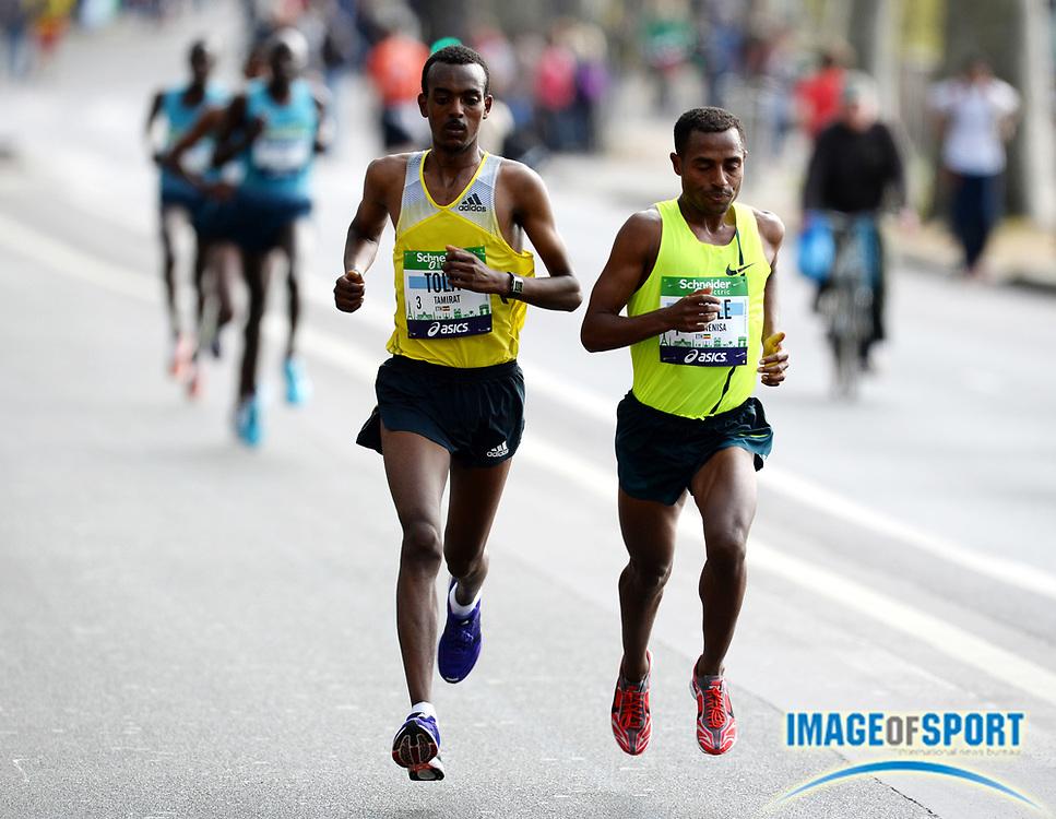 Apr 6, 2014; Paris, France; Kenenisa Bekele (ETH) and Tamirat Tola (ETH) lead the Schneider Electric Marathon de Paris. Bekele won in a course record 2:05.03 in his marathon debut. Photo by Jiro Mochizuki