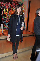 ALEXA CHUNG at a party to celebrate the switching on of the Christmas Lights at the Stella McCartney store, Bruton Street, London on 29th November 2011.