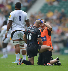 Saracens Fly-Half Charlie Hodgson revices treatment to his head.- Photo mandatory by-line: Alex James/JMP - 07966 386802 - 06/09/2014 - SPORT - RUGBY UNION - London, England - Twickenham Stadium - Saracens v Wasps - Aviva Premiership London Double Header.