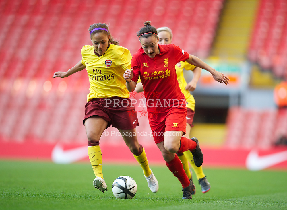 LIVERPOOL, ENGLAND - Friday, April 26, 2013: Liverpool's Lucy Bronze in action against Arsenal'a Alex Scott during the FA Women's Cup Semi-Final match at Anfield. (Pic by David Rawcliffe/Propaganda)