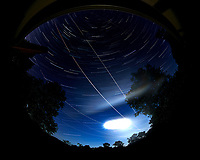 Star trails over New Jersey. Composite of images (23:30 to 00:29) taken with a Nikon D850 camera and 8-15 mm fisheye lens (ISO 100, 8 mm, f/4, 30 sec). Raw images processed with Capture One Pro, and the composite generated using Photoshop CC (statistics, maximum).