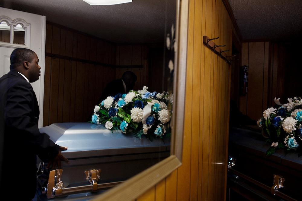 """The body of Demetrius """"Butta"""" Anderson, 18, is rolled into McKinney Chapel prior to his funeral in the Baptist Town neighborhood of Greenwood, Mississippi on Friday, November 5, 2010. Butta was shot and killed on October 27, 2010."""
