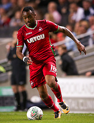 "Swansea's Jordan Ayew during the Carabao Cup, Second Round match at Stadium MK, Milton Keynes. PRESS ASSOCIATION Photo. Picture date: Tuesday August 22, 2017. See PA story SOCCER MK Dons. Photo credit should read: Scott Heavey/PA Wire. RESTRICTIONS: EDITORIAL USE ONLY No use with unauthorised audio, video, data, fixture lists, club/league logos or ""live"" services. Online in-match use limited to 75 images, no video emulation. No use in betting, games or single club/league/player publications."