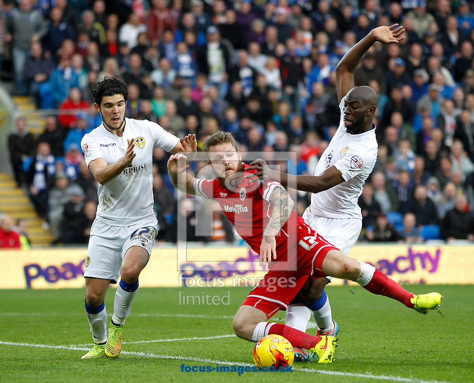 Aron Gunnarsson of Cardiff City and Souleymane Doukara of Leeds United during the Sky Bet Championship match at the Cardiff City Stadium, Cardiff<br /> Picture by Mike  Griffiths/Focus Images Ltd +44 7766 223933<br /> 01/11/2014