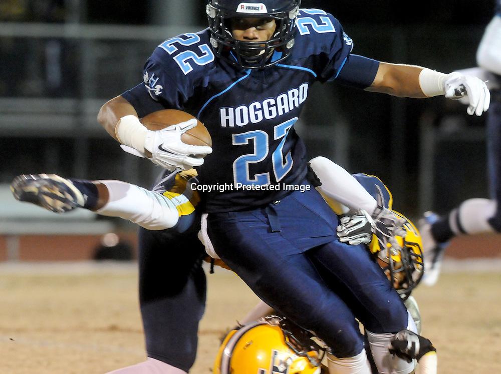 Hogard's Harrison Smith rushes against Cape Fear Friday November 21, 2014 at Hoggard High School in Wilmington, N.C. (Jason A. Frizzelle)