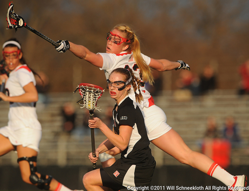 Rutgers junior midfielder Stephanie Anderson (13) defends Temple junior midfielder Charlotte Swavola (6).Temple defeated Rutgers 12-11 in NCAA women's college lacrosse at the Rutgers Turf Field in Piscataway, N.J.