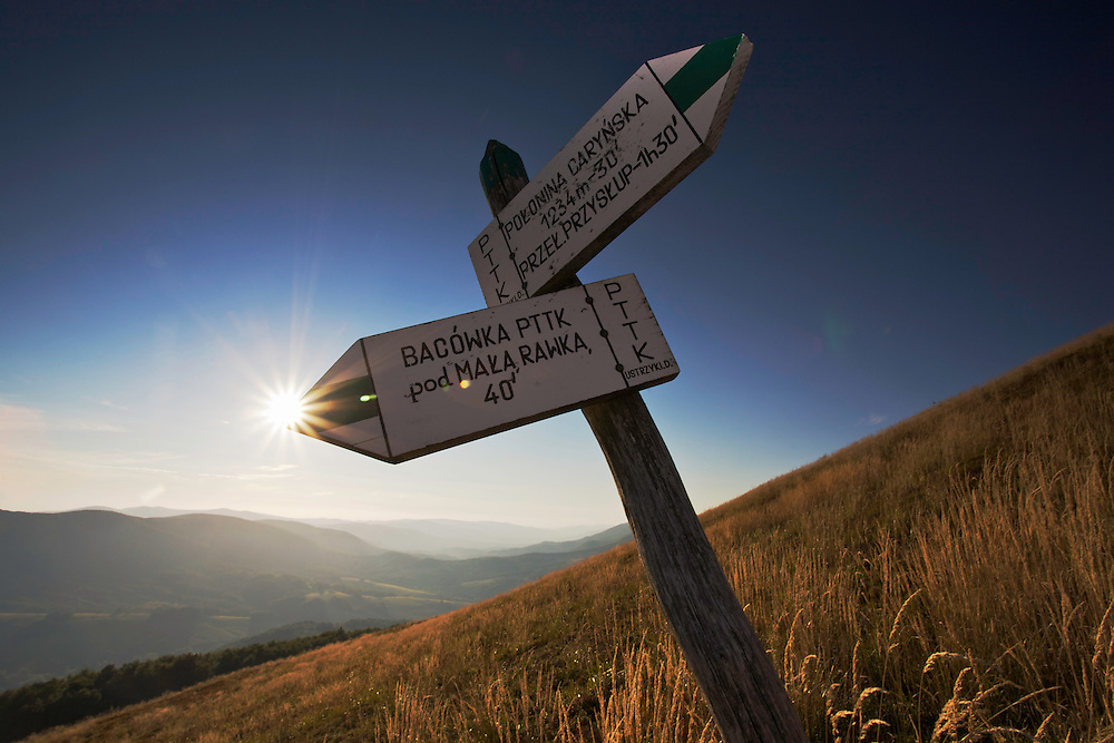 Signposts pointing to the highest mountain in Bieszczady National Park,  Ppolonina Carynska (1234 m). Ustrzyki Górne, Poland.
