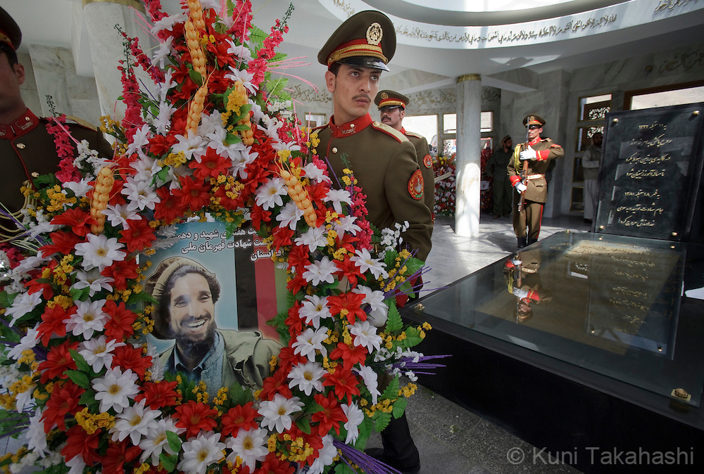 Afghan Honor Guards carry lay of flowers and a photo of late Commander Ahmad Shah Massoud in front of his tomb in Panjsher Province in Afghanistan on Sep 10, 2011 during a ceremony to mark the 10th anniversary of his assassination. Two foreign suicide assassins murdered Massoud, a military leader who played a leading role in driving the Soviet army out of Afghanistan, on Sept. 9, 2001 in Takhar province of Afghanistan..(Photo by Kuni Takahashi)