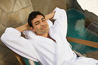 Man in bathrobe, relaxing outdoors