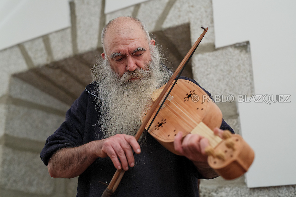 02/12/2016. Jesus Reolid plays a viol during an exhibition of musical instruments from medieval times recently made by luthiers at the Santa María la Real de Valdeiglesias Monastery on December 2, 2016 in Pelayos de la Presa, Madrid province, Spain. The Collegiate of Santa María la Mayor is a Romanesque architecture church built during the 12th and 13th centuries. Recents restorations of the Church discovered many details on its sculptures. Then luthiers started the project 'De la piedra a la madera' to recover and to reproduce the instruments displayed on the North Gate. (© Pablo Blazquez)