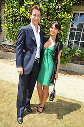 The HON.WILL ASTOR and LOHRALEE STUTZ at a luncheon hosted by Cartier for their sponsorship of the Style et Luxe part of the Goodwood Festival of Speed at Goodwood House, West Sussex on 5th July 2009.
