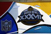 Super Bowl XXXVII Flag flies over the stadium at Super Bowl XXXVII in San Diego on 01/26/2003. The Tampa Bay Buccaneers defeated the Oakland Raiders 48 to 21. ©Paul Anthony Spinelli